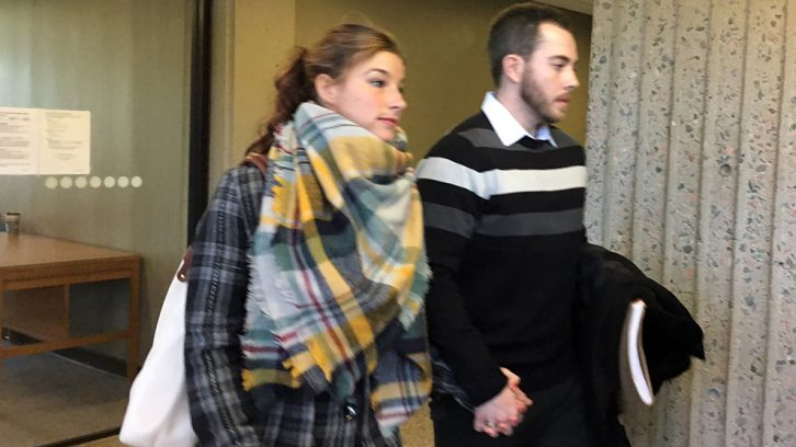 Christopher Garnier and girlfriend Brittany Francis exit the courtroom Thursday morning.