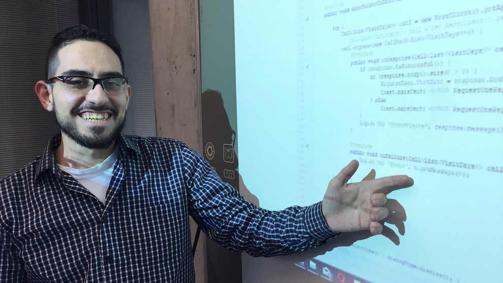 Mohammed Zaher Abd Ulmouli shows off some Java code he's written.