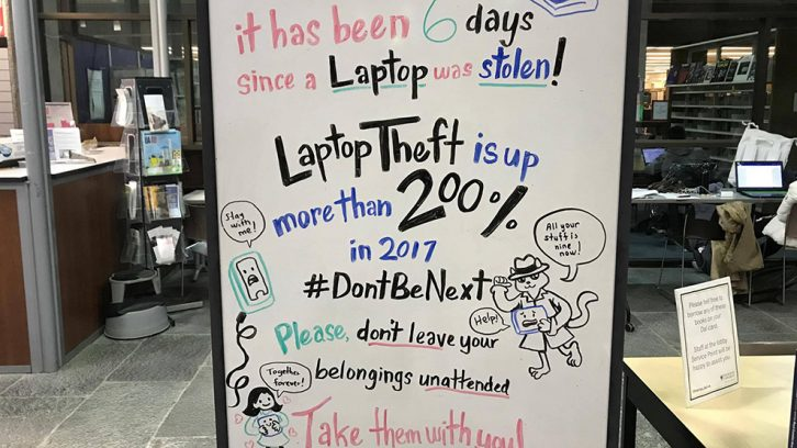 A sign warning students about laptop theft is located on the second floor of the Killam Memorial Library.