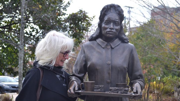 Artist Marlene Hilton Moore sculpted three women contributing to the war effort.