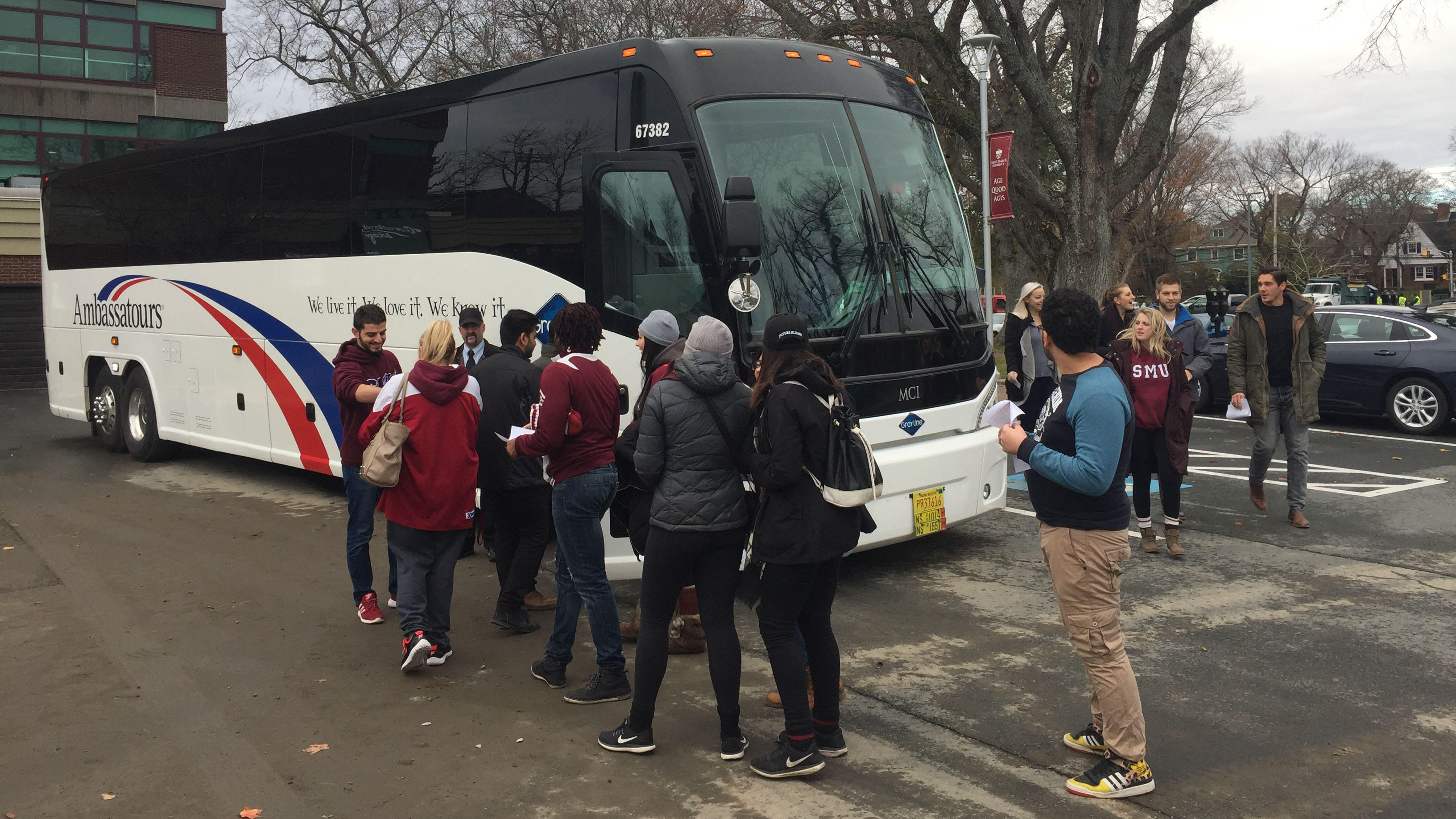 SMU fans board a bus to Acadia to cheer on the Huskies