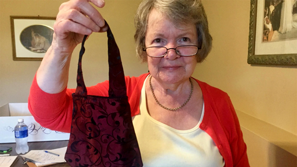 Heather Inglis-Quinn shows off one of her Eco-Couture handbags at her home studio in Eastern Passage, N.S.