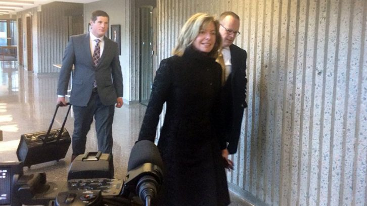 SMU lawyers walking towards courtroom 301 on Saturday afternoon.