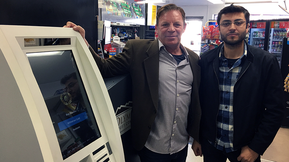 Stephen Offman and Akram Ayach of Coin Nations ATMs pose next to the machine at Daily Sweets.