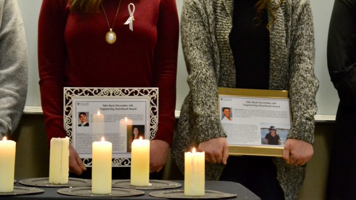 The 14 students lit a candle for each of the victims.
