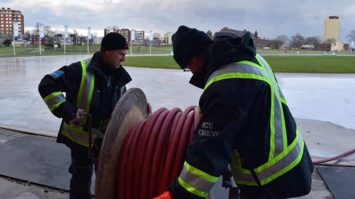 Bruce Carmody and Bernie Cooper started the afternoon shift by rolling out the water hose.
