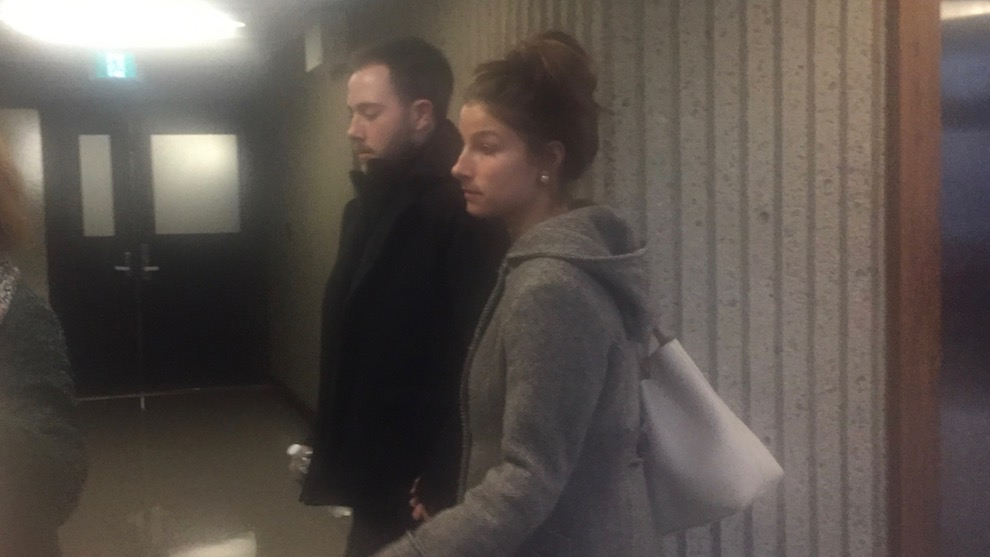 Christopher Garnier walks into courtroom 304 with his girlfriend, Brittany Francis, on Wednesday.
