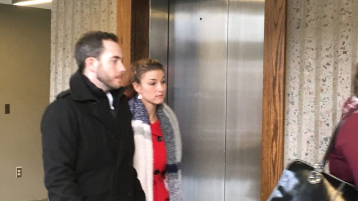 Christopher Garnier and his girlfriend Brittany Francis leaving the courtroom.