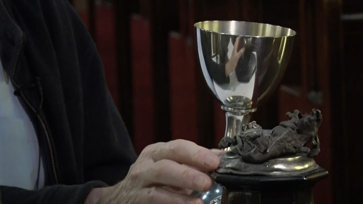 A current chalice, and one melted in the fire caused by the Explosion at the original St. Mark's Church.