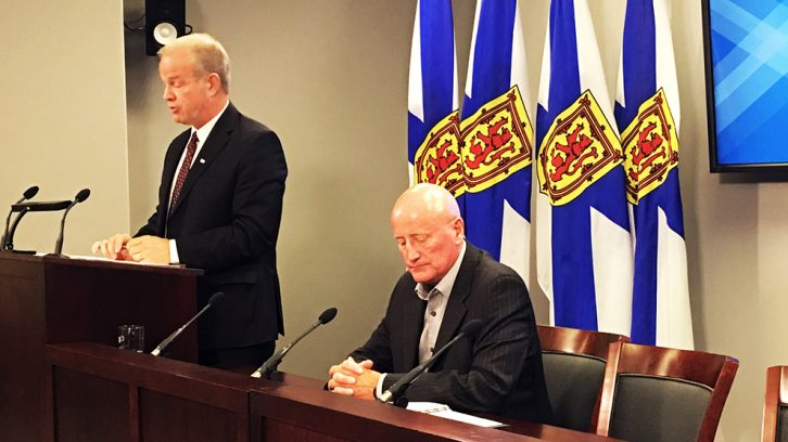 Minister of labour relations Mark Furey (left) and government negotiator Rollie King (right) announced a decision Thursday that wages will increase for NSGEU workers.