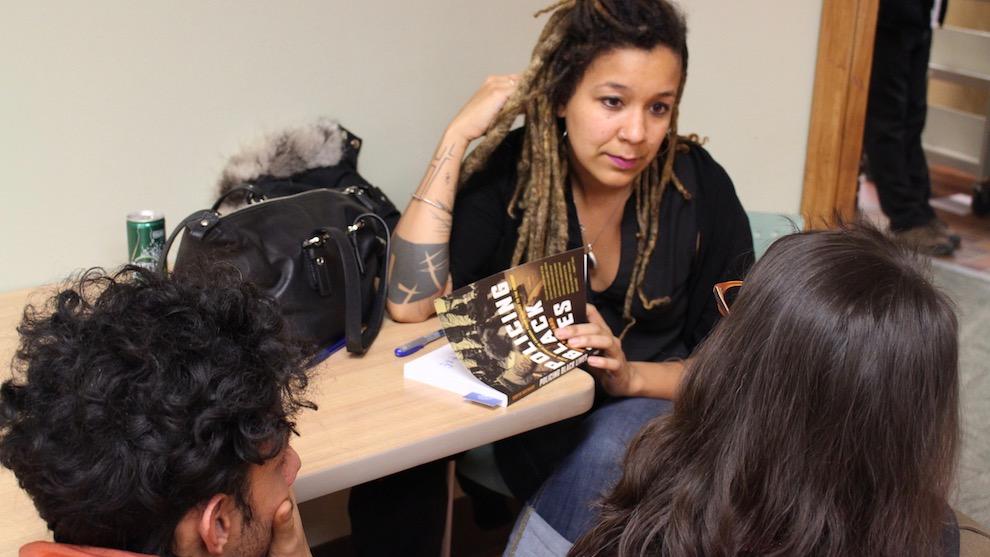 Robyn Maynard signs copies of her books for fans.