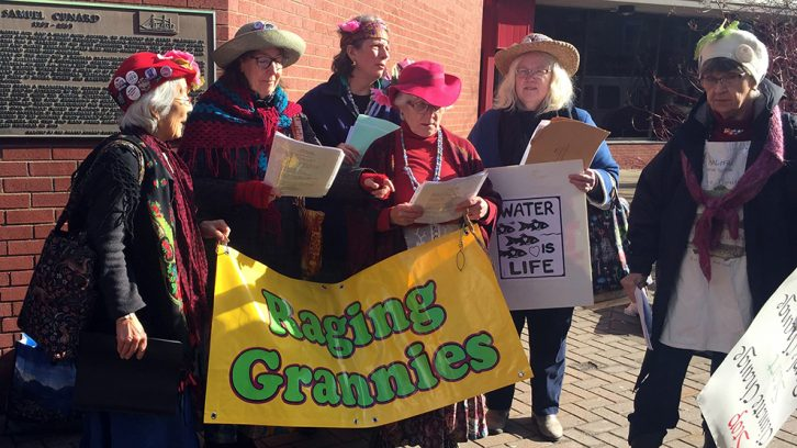 A group of women participate in the Offshore Alliance demonstration on Wednesday