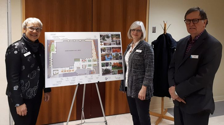 Sue Sirrs (left), Helen Thexton (center) and Terry Gallagher (right) present a diagram of the new design