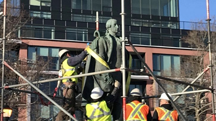 The statue is tied down.
