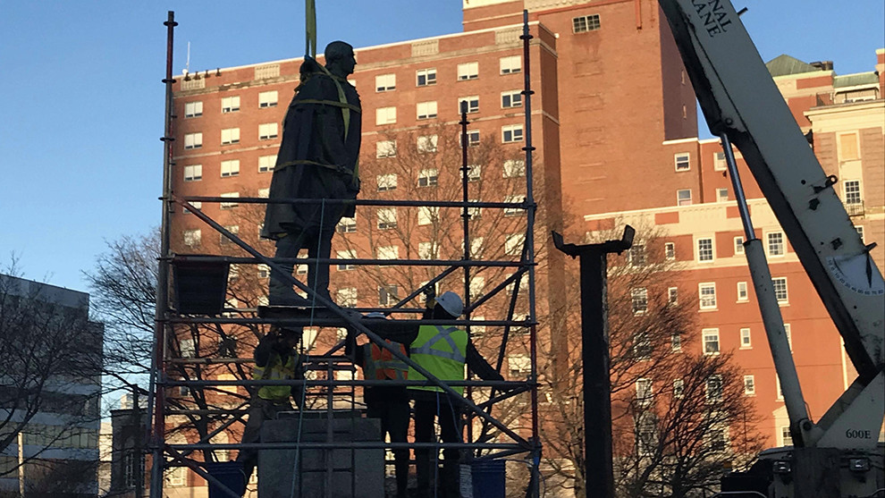 The statue is being lifted off