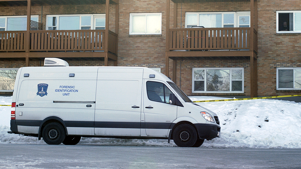 The Forensic Identification Unit remained outside Farthington Place Monday afternoon.
