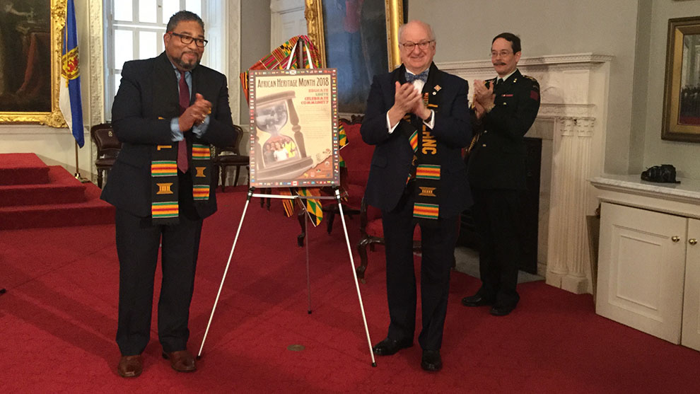 Tony Ince and Lt.-Gov Arthur LeBlanc reveal the poster for this year's African Heritage Month.