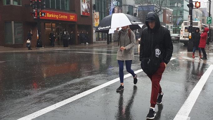 Pedestrians brave Saturday's weather on Spring Garden Road