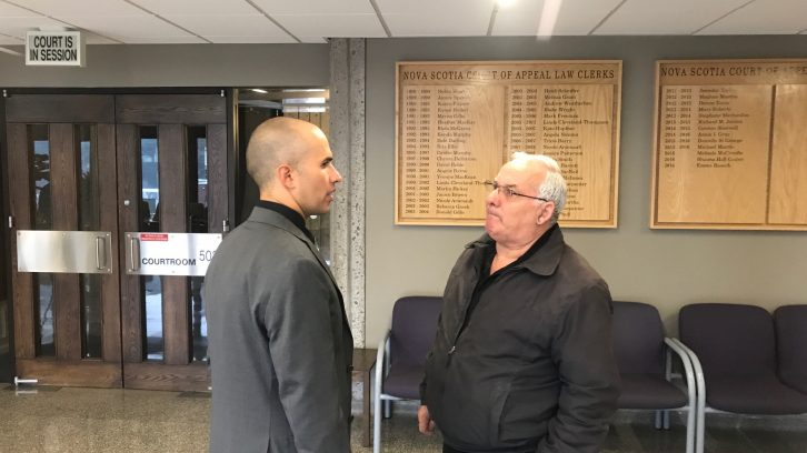 Grabher and his lawyer Jay Cameron during a short recess on Thursday