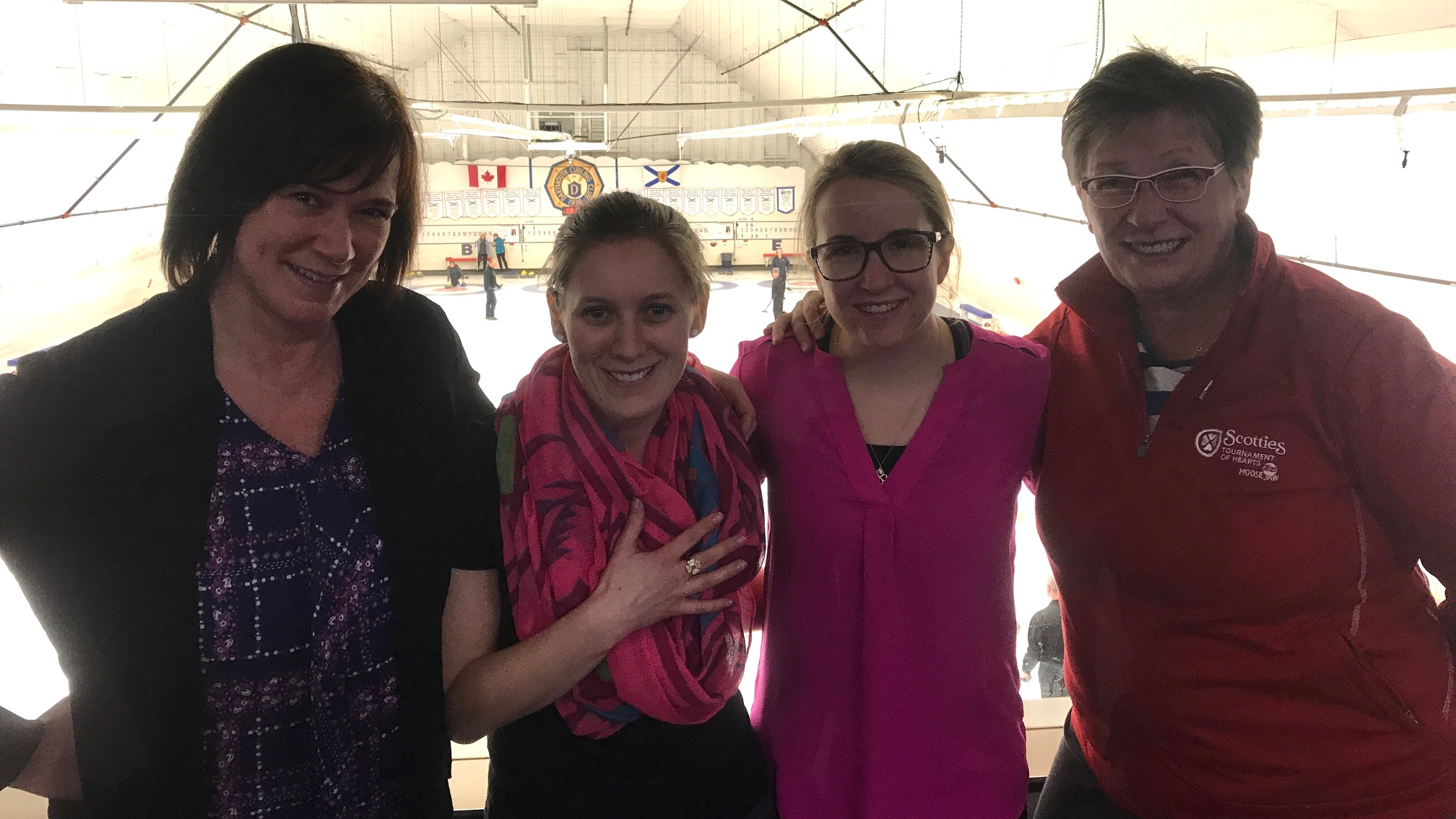 Skip Mary-Anne Arsenault, Second Jenn Baxter, Third Christina Black and Coach Carole MacLean at the Dartmouth Curling Club on Wednesday. Baxter is showing off the ring awarded for winning bronze at this year's Scotties.