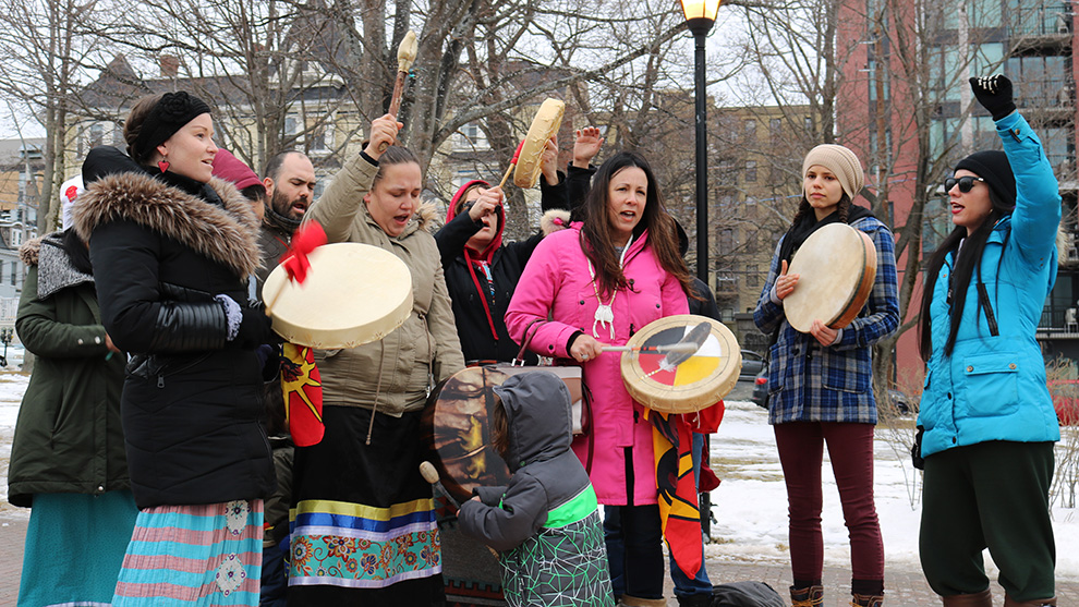 Mi'kmaq members sing a traditional Mi'kmaq song to celebrate.