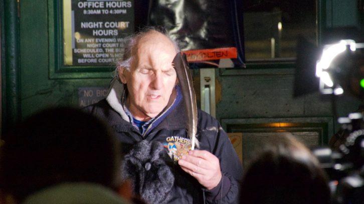 Mi'kmaq elder Billy Lewis holds sacred feather.