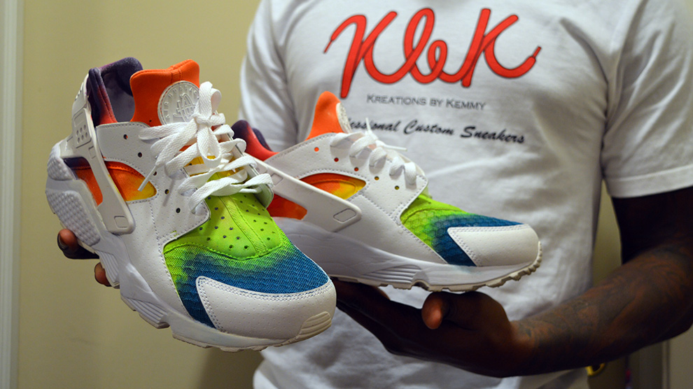 Kemmy Smith holds up a pair of his Skittles-inspired sneakers.