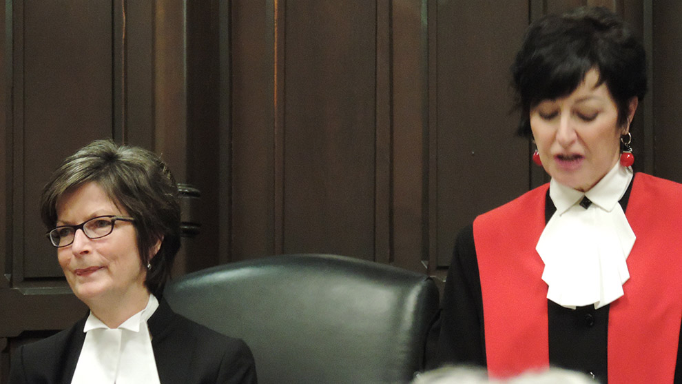 Chief Judge Pamela Williams (left) introduces newest judge Honourable Ann Marie Simmons (right) before she is robed in red.