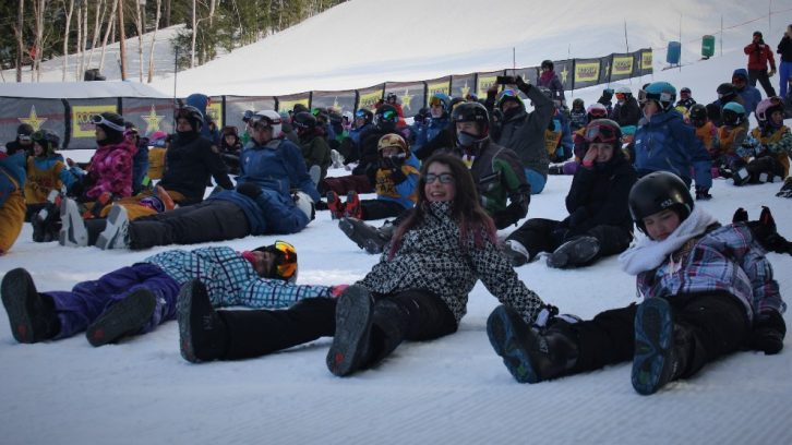 People getting ready to make snow angels.