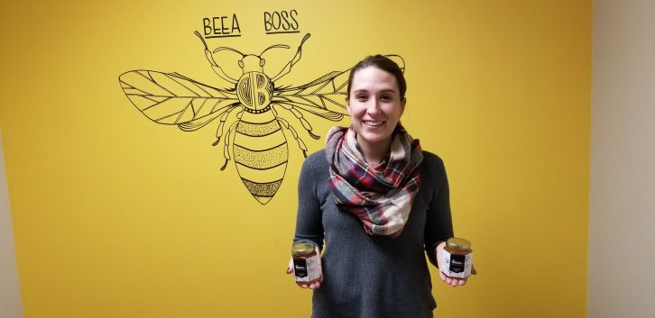 Kimberly Drisdelle, facilitator of BEEA Honey with a Heart, stands with some of the group's honey.