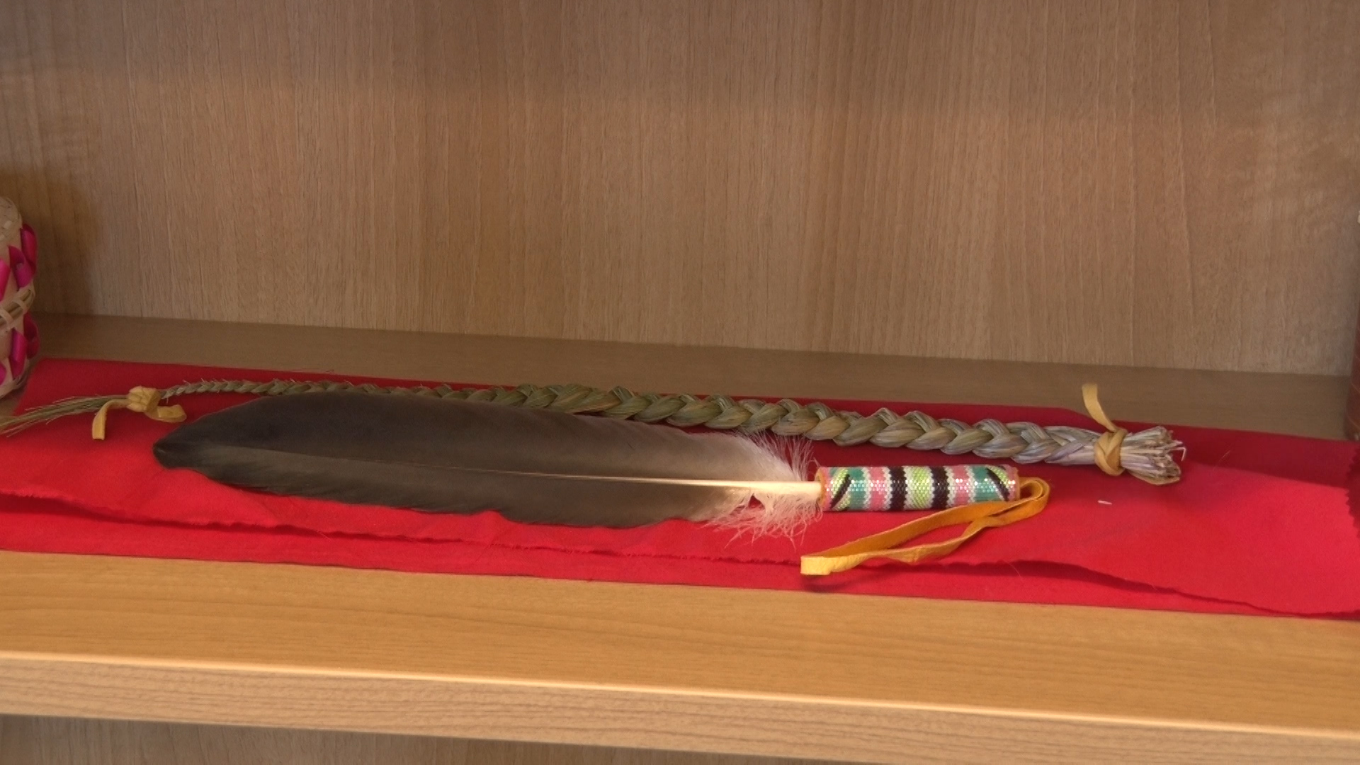 An eagle feather kept by Aaron Prosper on a shelf in his office at the Dalhousie Student Union.