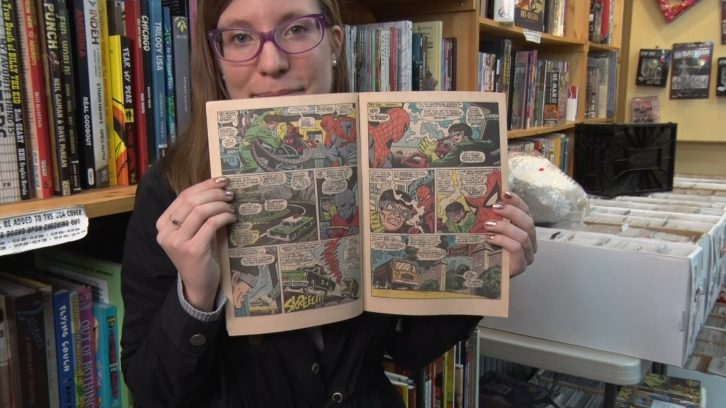 "Bethany Ambrose reads a Marvel Comic at Strange Adventures on Wednesday. Ambrose met Lee at a comic convention and says he had ""the most genuine, sweet smile."""