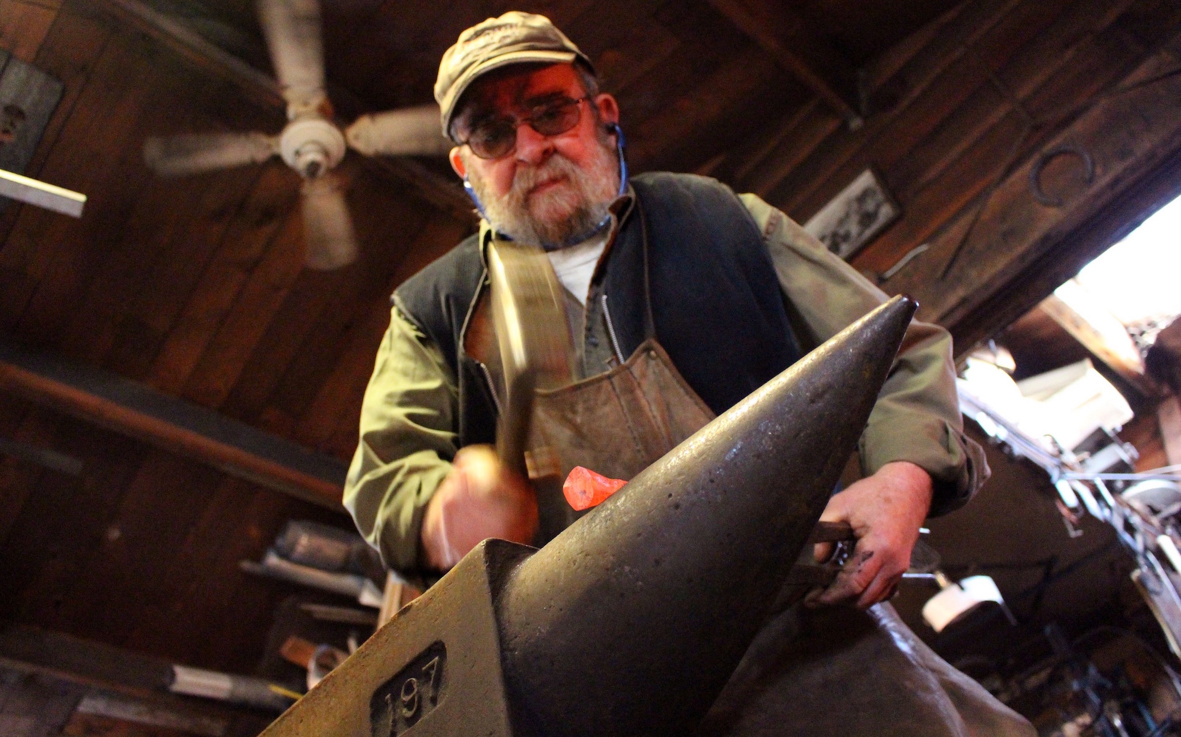 John Little hammers on his anvil in his East Dover forge. He has been blacksmithing for 48 years.