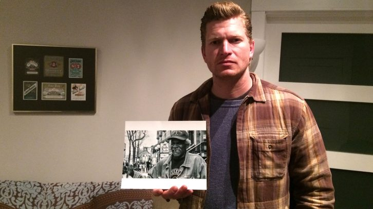Blues musician Buck Tingley holds a picture of Lazy Lester, who he met and performed with in 2014.