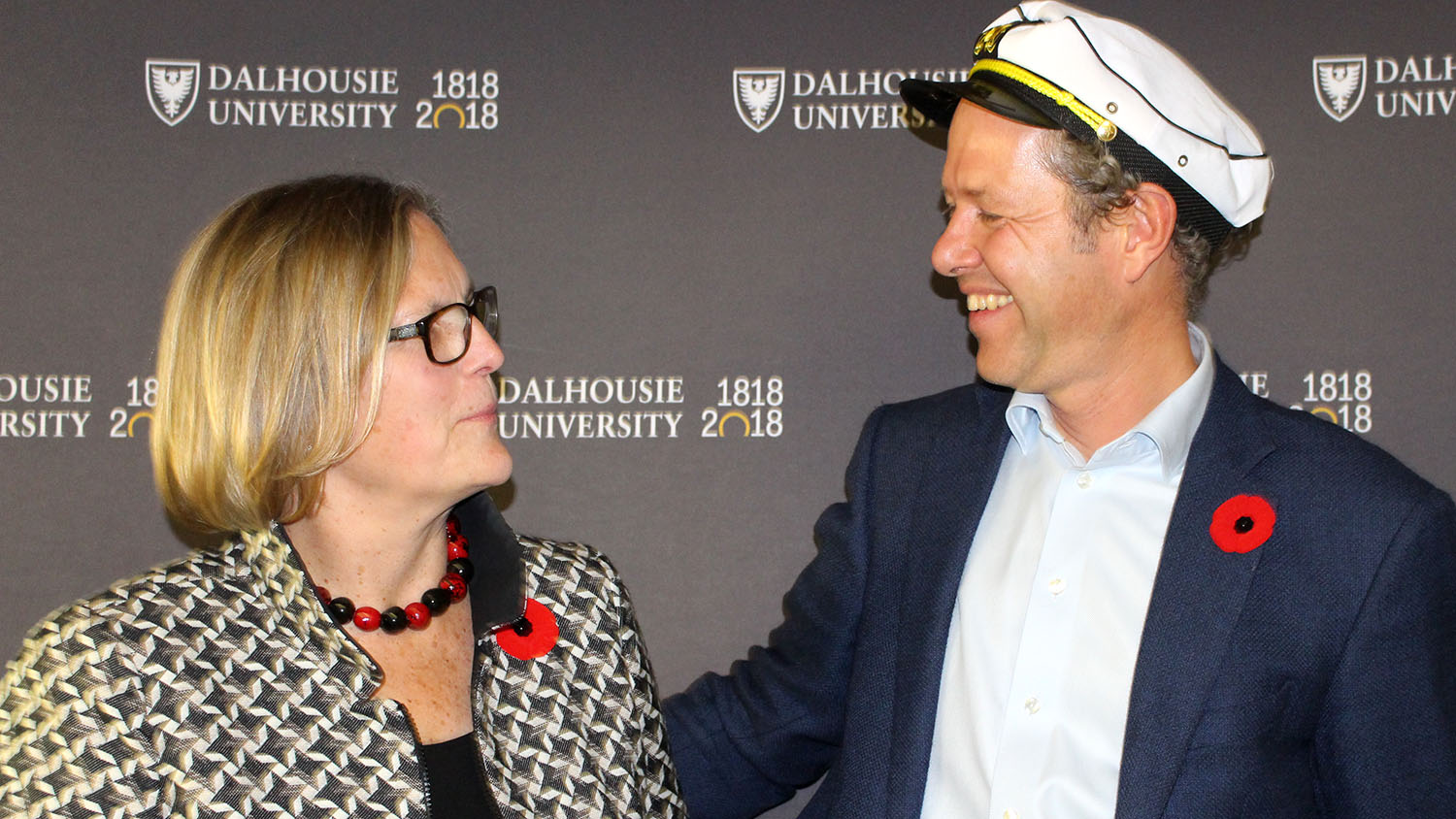 Kathryn Sullivan reconciles with opponent Boris Worm after the Great Debate at Dalhousie University.