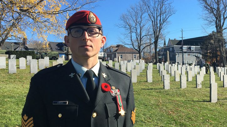 soldier stands in cemetery