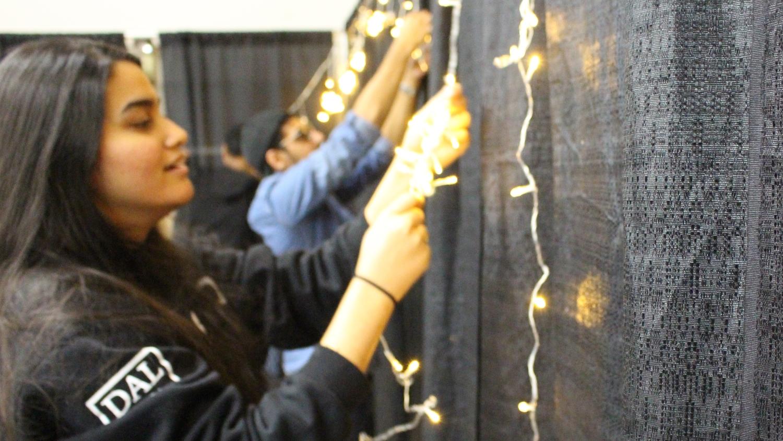 Volunteers untangle lights to prepare for Diwali.