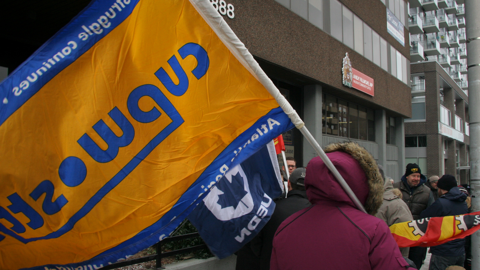 Supporters gathered in front of MP Andy Fillmore's office to stand with striking postal workers.