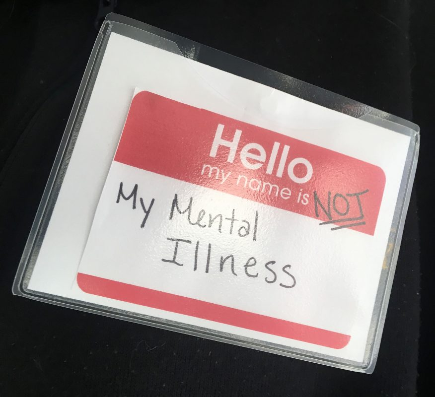 "A name tag that says ""Hello, I am not my mental illness""."