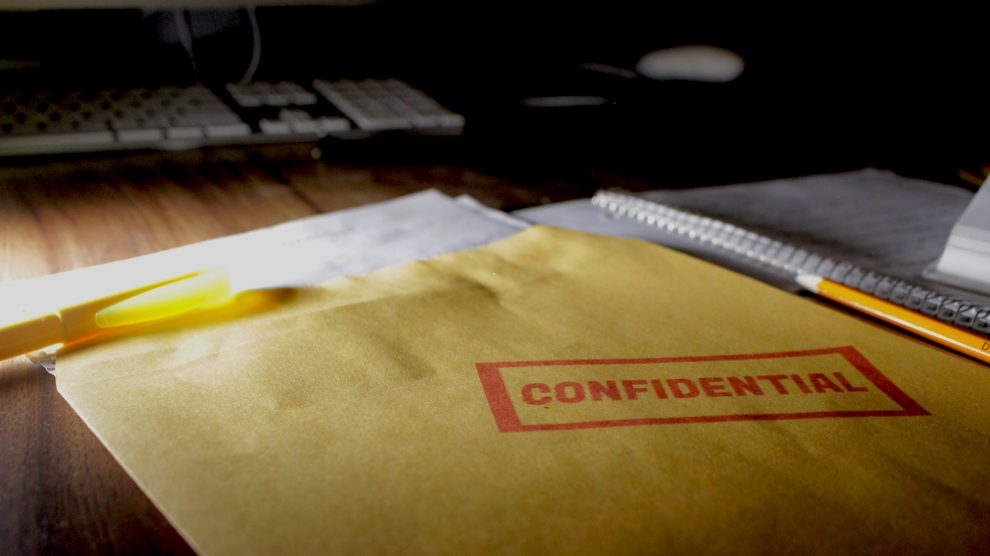 An envelope stamped confidential sits on a desk in this photo illustration.