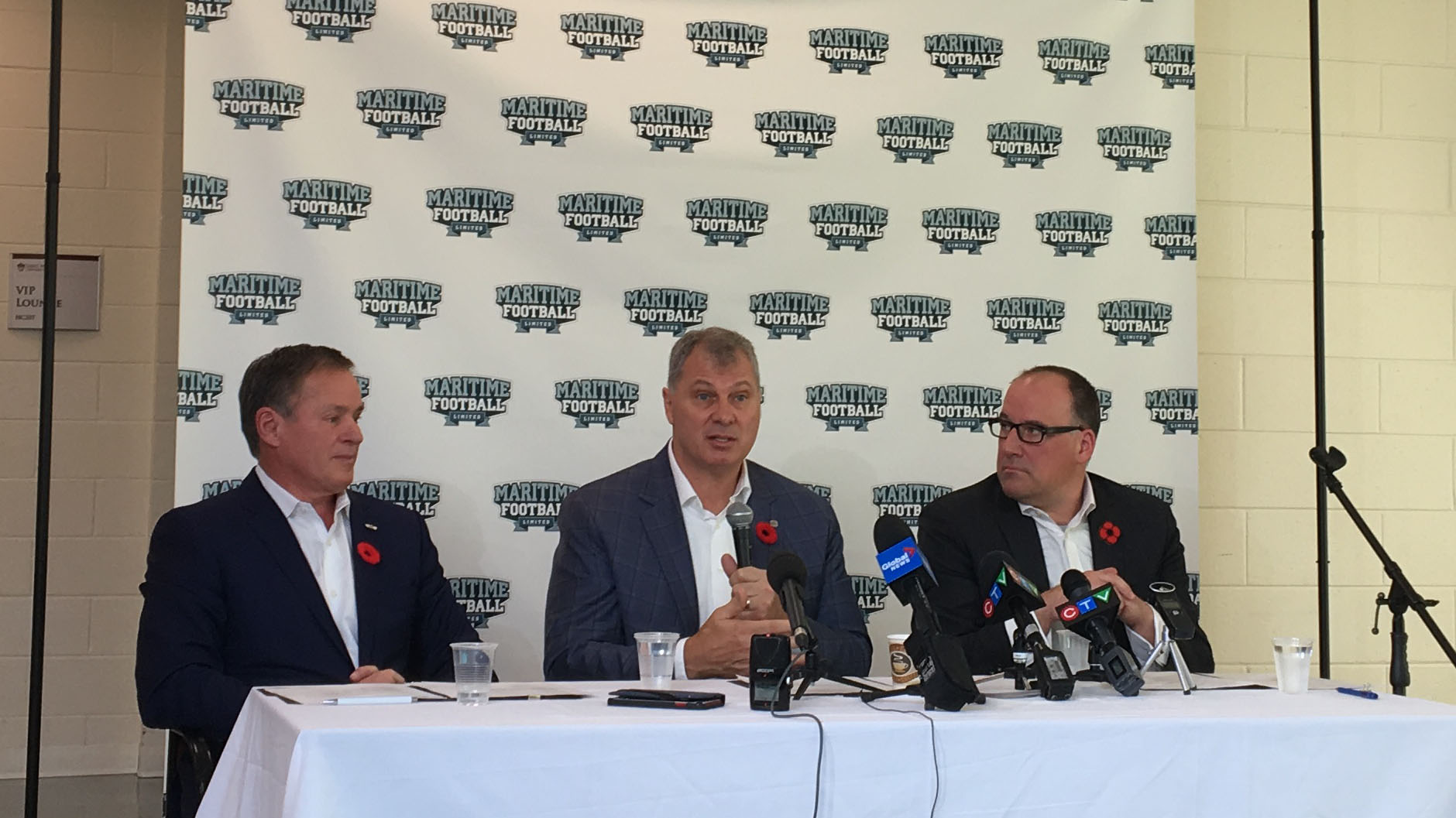 CFL Commissioner Randy Ambrosie (centre) answers questions while Bruce Bowser (left) and Anthony LeBlanc (right) founding partners of Maritime Football Ltd. listen at the Nov. 7 press conference