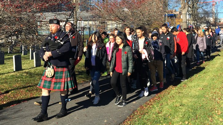 students arrive at cemetery