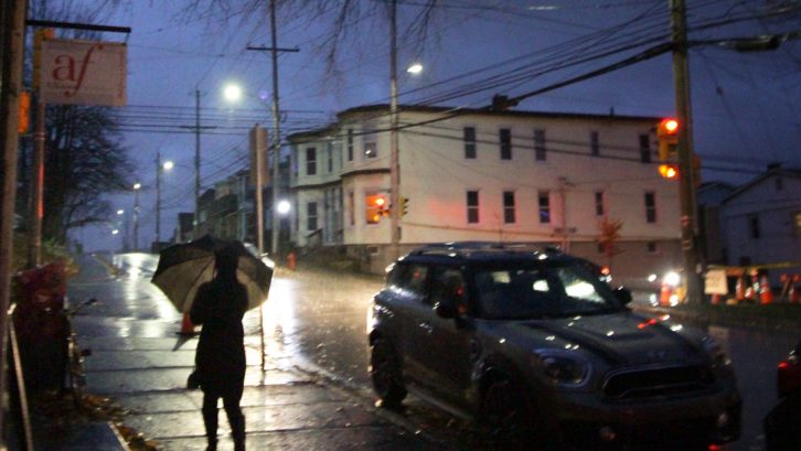 A pedestrian walks in the rain in Halifax's Hydrostone neighbourhood