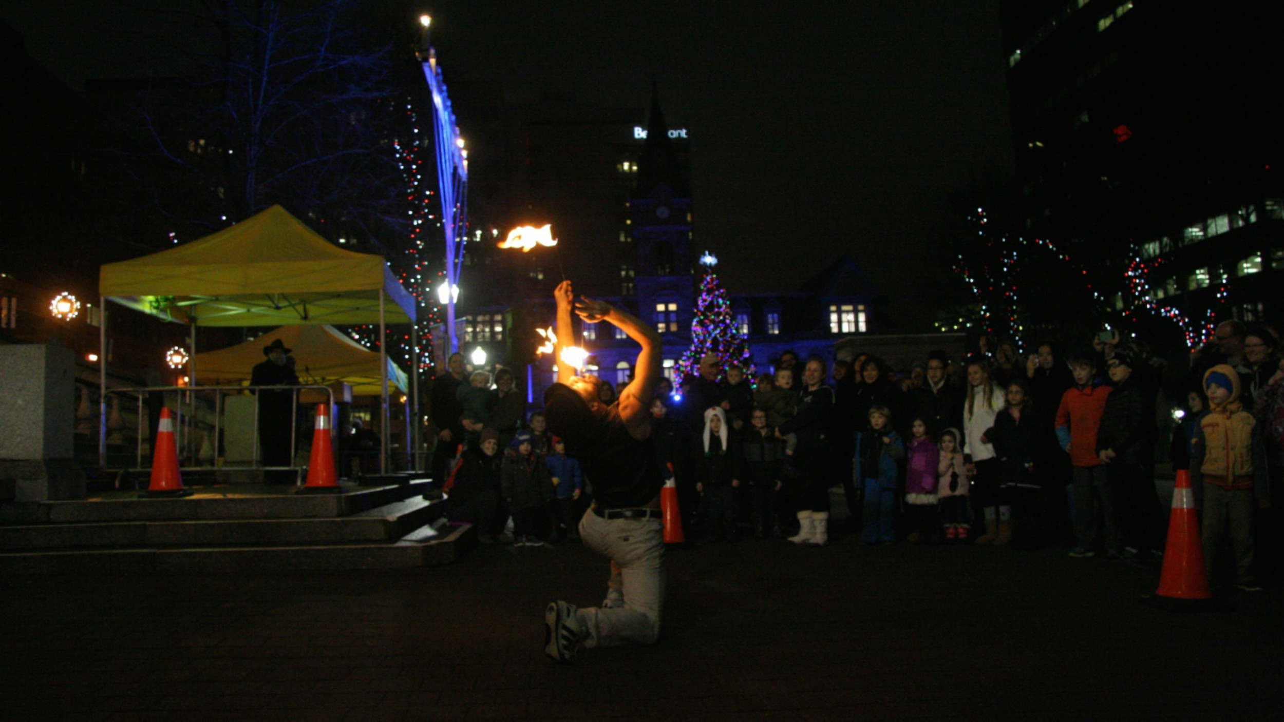 Kyle Scott performs at the side of the menorah at Halifax Grand Parade on Monday night.