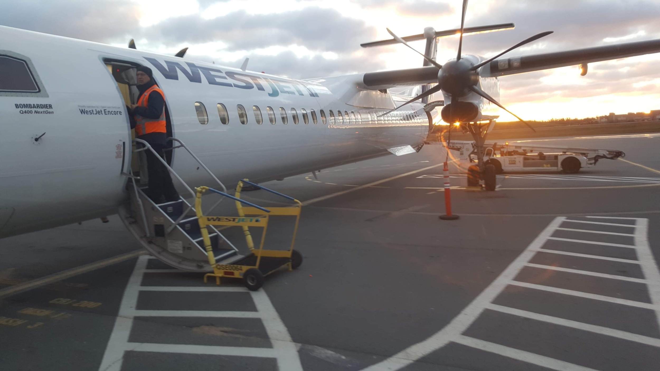 A WestJet airplane sits on the tarmac at the Halifax Stanfield International Airport.