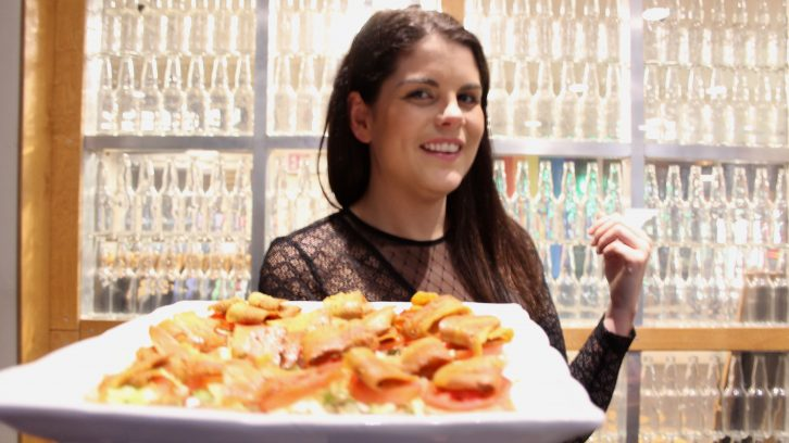 Real Fake Meat owner Lauren Marshall with a plate of BLT sliders made from coconut bacon.