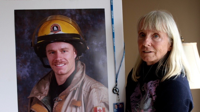 Claudia Currie holds a picture of her son. Kyle Currie, a Halifax firefighter for 10 years, took his own life on Oct. 2.