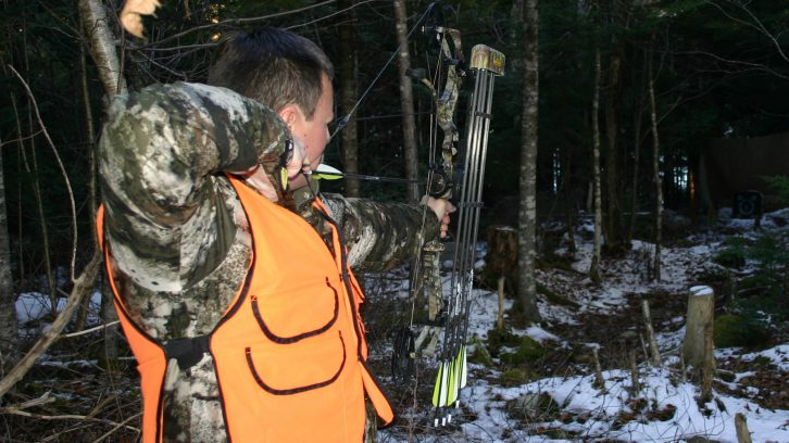 Marcel Tellier aims his arrow at his target. Sunday hunting is allowed for the first two Sundays of the season in Nova Scotia.