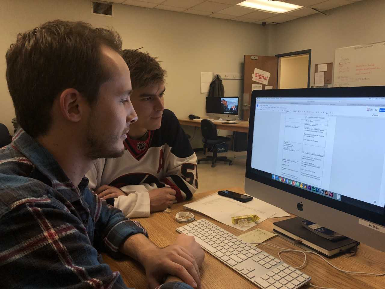 Hosts Ben Cleary and Benjamin Wilson working on scripts for today's final livestream from The Signal's video workshop