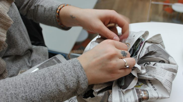 Wrapping gifts with newspaper is a sustainable alternative to non-recyclable wrapping paper.
